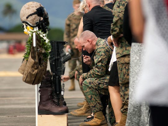 Family, friends and comrads pay their respects during a memorial service for the 12 U.S. Marines who died when their helicopters crashed off the North Shore of Oahu.