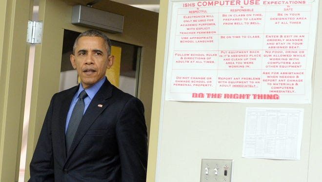 President Barack Obama arrives to deliver a brief statement in a classroom at Indian Springs High School on Friday, Dec. 18, 2015, in San Bernardino, Calif. Obama opened his Christmas vacation on a somber note: meeting with families of the 14 people who were killed in the San Bernardino shooting. (Will Lester/The Sun via AP, Pool)