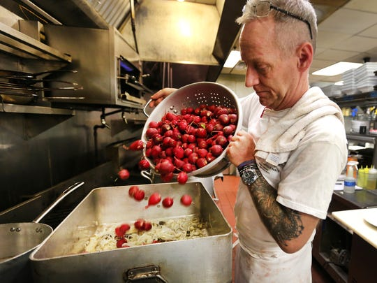 Jimmy Gibson, executive chef and co-owner of Jimmy G's in downtown Cincinnati, volunteers to create soup for La Soupe twice monthly. He never knows what produce he'll receive, like when he got a large quantity of radishes. He turned it into ginger, turnip and beef soup that people raved about.