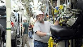 Rick Twitty installs seats into 2012 Toyota Highlander vehicles at the Toyota Motor Manufacturing Indiana, Inc., plant in Princeton, Ind., on Feb. 2, 2012.