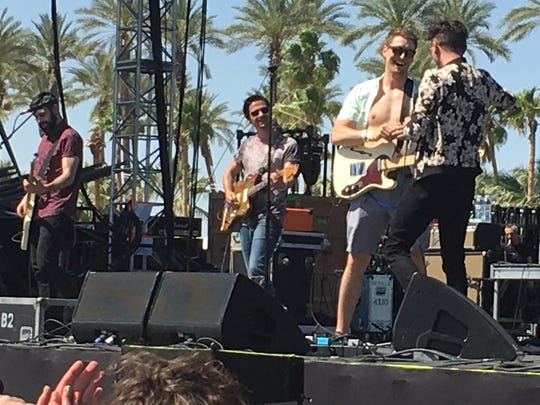 Ross Watt (sunglasses) smiles at Arkells frontman Max Kerman who plucked Watt from the crowd to play guitar with the band during the Coachella set Saturday.