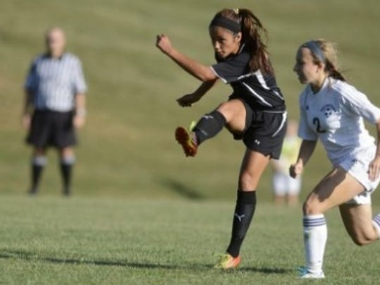 Central York's Katie Hackos takes a shot on goal against Dallastown's Caroline Kaschak during the girls' soccer game at Dallastown Area High School Thursday, September 5, 2013. Both will be in Sunday's YAIAA senior all-star match. (DAILY RECORD/SUNDAY NEWS - KATE PENN)