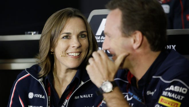 Claire Williams, left, with Williams Formula One team, chats with Red Bull's Christian Horner, in 2013.