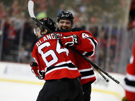 New Jersey Devils left wing Joseph Blandisi (64) and