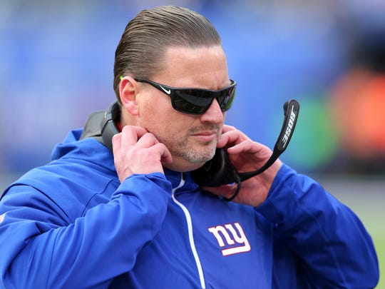 New York Giants head coach Ben McAdoo adjusts his headset during the second quarter against the Kansas City Chiefs at MetLife Stadium.