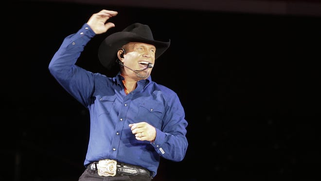 """Garth Brooks, pictured here  singing """"Ain't Going Down"""" during a concert in New York, is one of many big names scheduled to perform in Greenville in the coming months."""