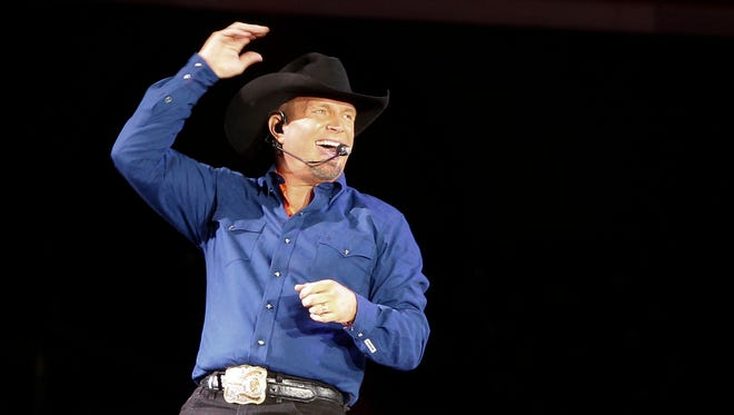 """Garth Brooks sings """"Ain't Going Down"""" for his opening song during a performance at Yankee Stadium, Friday, July 8, 2016, in New York."""