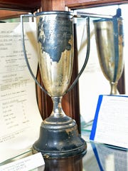 A sports trophy from 1928 is on display. Historian