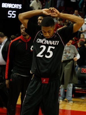 Bearcats guard Kevin Johnson can only look down at the court after his three-pointer missed at the buzzer in the second overtime.