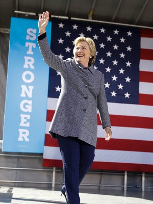 Democratic presidential candidate Hillary Clinton takes the stage during a campaign stop in Des Moines, Iowa.