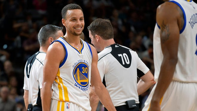 Golden State Warriors guard Stephen Curry (30) smiles during the second half of an NBA basketball game against the San Antonio Spurs, Sunday, April 10, 2016, in San Antonio. Golden State won 92-86.