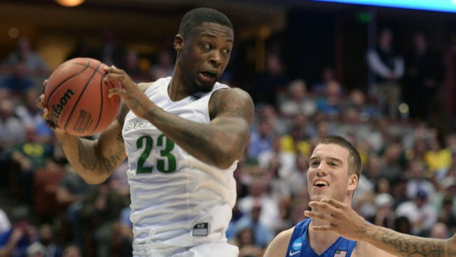March 24, 2016; Anaheim, CA, USA; Oregon Ducks forward Elgin Cook (23) grabs a rebound against Duke Blue Devils during the second half of the semifinal game in the West regional of the NCAA Tournament at Honda Center. Mandatory Credit: Robert Hanashiro USA TODAY Sports