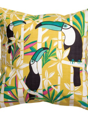 Toucans peek out from bamboo on a throw pillow from H & M Home.
