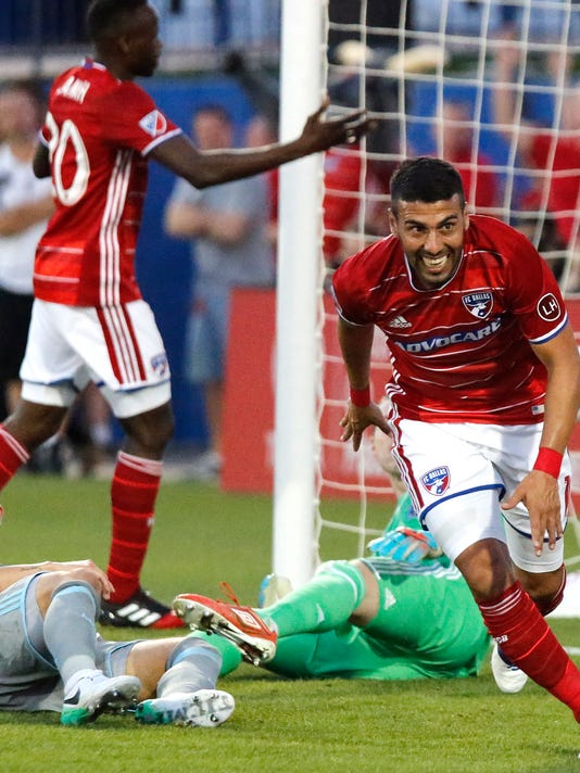 FC Dallas midfielder Javier Morales (11) celebrates the first goal of the evening during the first half of an MLS soccer match against Minnesota United at Toyota Stadium in Frisco, Texas on Saturday, April 8, 2017. (Stewart F. House/The Dallas Morning News via AP)