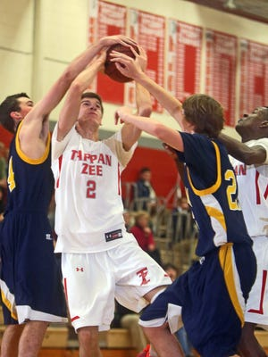 Tappan Zee's Luke McLaughlin tries to shoot as he is pressured by Pelham defenders during Monday's game at Tappan Zee High School. McLaughlin finished with 24 points as Tappan Zee defeated Pelham 61-34.