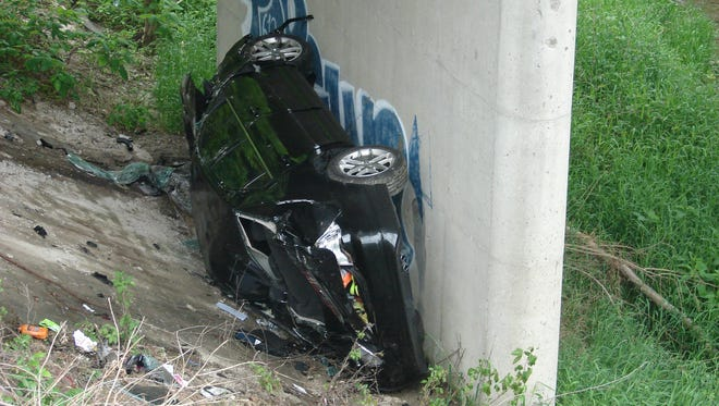 Indiana State Police say an Indianapolis woman's car left I-65 and rolled under a bridge between 2 and 4 a.m. Monday.