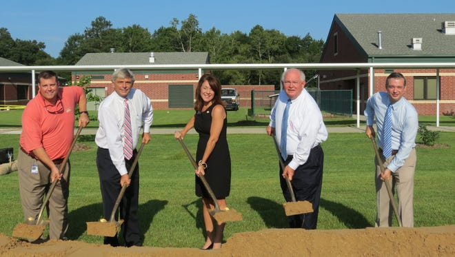 Construction begins on Montford Middle School's new classroom wing. Left to right: Assistant Superintendent Scotty Crowe, Superintendent Jackie Pons, School Board member Alva Striplin, Sen. Bill Montford and Principal Lewis Blessing