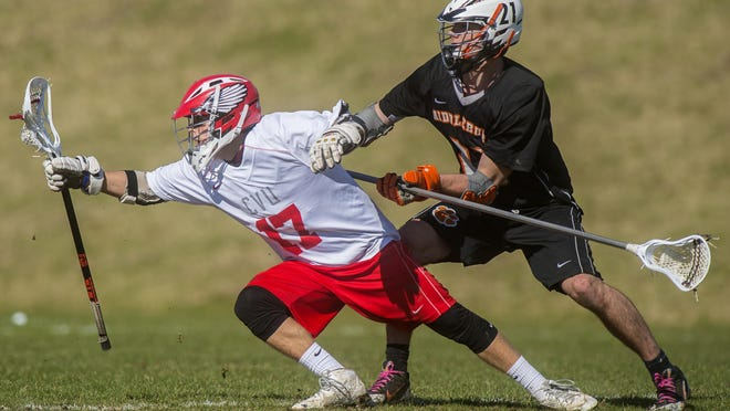 CVU's Cam Rivard, left, tries to keep the ball away from Middlebury's Austin Robinson in Hinesburg earlier this season.