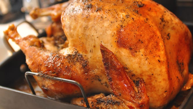 The easy turkey recipe begins by roasting the bird at high heat, then finishing at low heat.