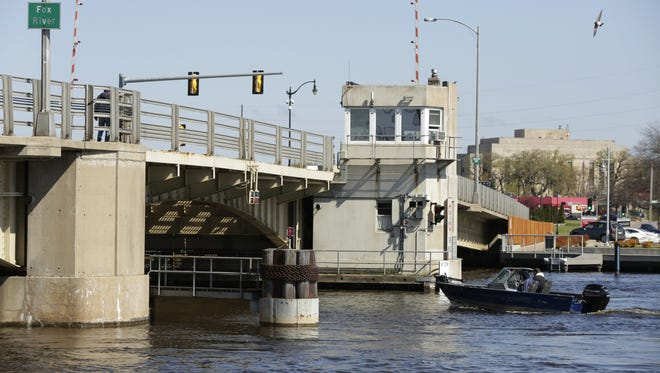 A boat prepares to travel under the Oregon Street bridge Friday, May 5, 2017, in Oshkosh. The Oshkosh Common Council is evaluating plans to replace or resurface the Oregon Street drawbridge, which is nearing the end of its useful life.