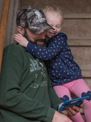 Jack Lentz and daughter Piper, 3 years old, playing.