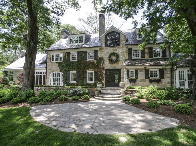 This stone manor located on four acres just off of Binford Boulevard is for sale for $2.4 million. It includes a three-car attached garage. The owners spent $1 million renovating the 1936 home.