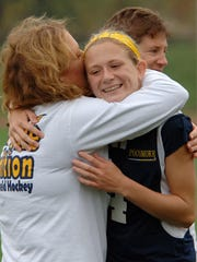 Pocomoke head coach Susan Pusey hugs Taylor West, who scored several goals, after Pocomoke defeated Glenelg in the State Championship Game at Washington College in Chestertown in 2008.