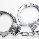 Handcuffs against white background