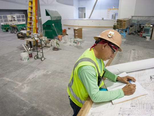 Electrical Superintendent Misael Barcenas takes notes in the new Southwest Florida Performing Arts Center under construction at the corner of Bonita Beach Road and Imperial Parkway in Bonita Beach on Thursday, April 14, 2016.  (Photo by Gregg Pachkowski/Special to the Daily News)
