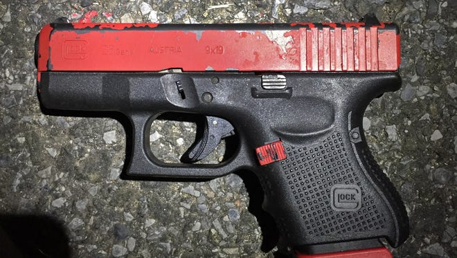 Ohio law currently requires people stopped by a police officer to share if they have a concealed handgun. This photo released by the New York Police Department shows a 9mm Glock 26 pistol.
