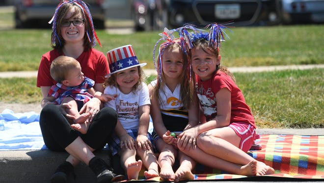The Waterous sisters await the start of the Windsor Heights Fourth of July parade in 2017.