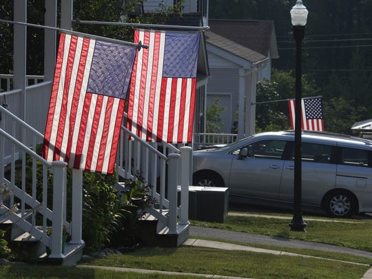 Flags are lowered Wednesday morning, July 12, 2017, at the Stewart Terrace Community in New Windsor, New York. The community is located close to the Stewart Air National Guard base, which lost nine Marine reservists in a plane crash in Mississippi on July 10, 2017, that killed 16.