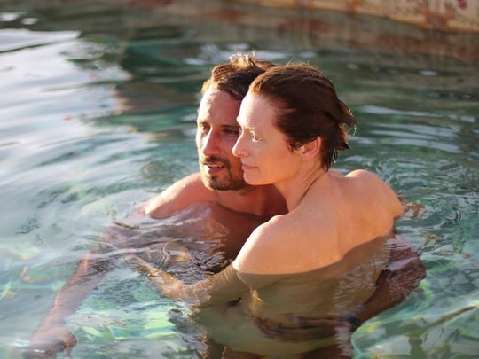 "Paul (Matthias Schoenaerts) and Marianne (Tilda Swinton) are relaxing in ""A Bigger Splash,"" but that's about to change."
