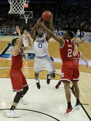 Seton Hall guard Khadeen Carrington (0) puts up a shot during the first half of an NCAA men's college basketball tournament first-round game against North Carolina State Thursday, March 15, 2018, in Wichita, Kan.