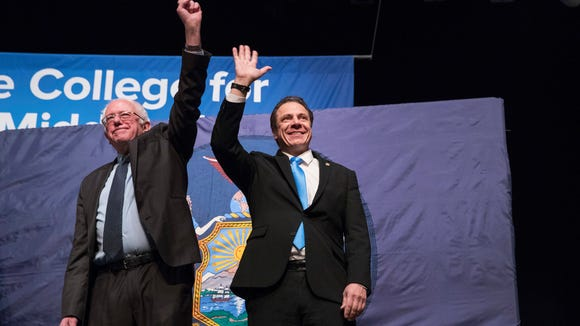 New York Gov. Andrew Cuomo, right and Vermont Sen.