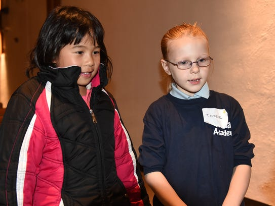 Thornton Creek student Diane Zhao, left, and Detroit's
