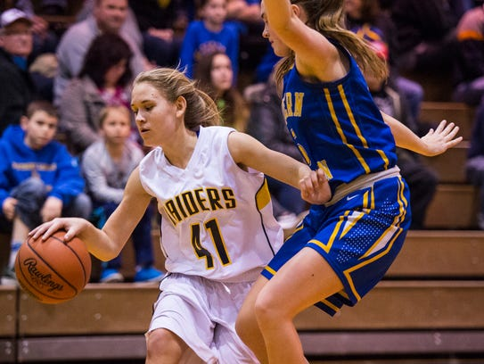 Elco's Julia Nelson drives to the hoop against Northern