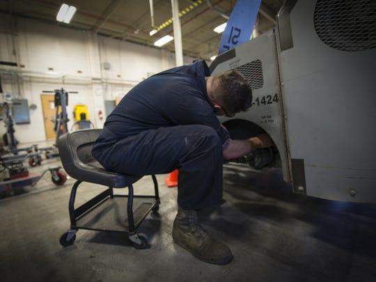 Airman 1st Class Casey Ross, a 49th Maintenance Squadron Aerospace Ground Equipment technician, replaces a rear wheel assembly on an MJ-1B bomb lift, at Holloman Air Force Base, N.M., on Jan. 12, 2017. Holloman's AGE Airmen perform a wide variety of maintenance duties in support of aircraft maintenance and flying operations.