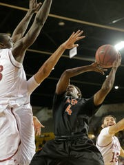 UTEP's Lee Moore goes into traffic during the first
