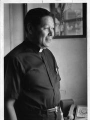 The late Msgr. Jose Leon Guerrero is shown in his office