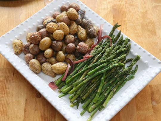 Herb-roasted potatoes and roasted asparagus bake in