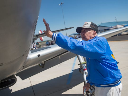 Veteran Gerald Ravenscroft admires a P-51 Mustang during
