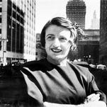 Ayn Rand, Russian-born American novelist, is shown in Manhattan with the Grand Central Terminal building in background in 1962.  (AP Photo)