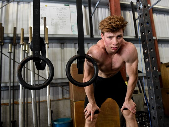 Ethan Elwel, 17, shown in this July 3 file photo, finished fifth in the CrossFit Games despite having to compete for much of the competition with a broken rib.