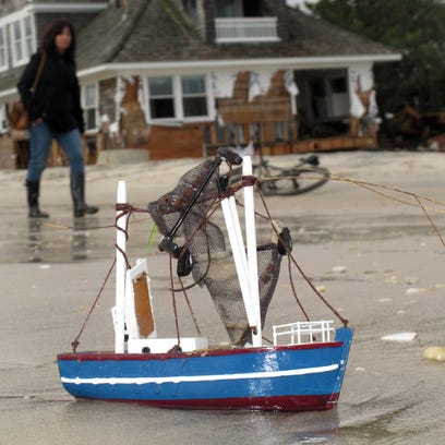 Hurricanes stall start of New Jersey beach repair from Sandy