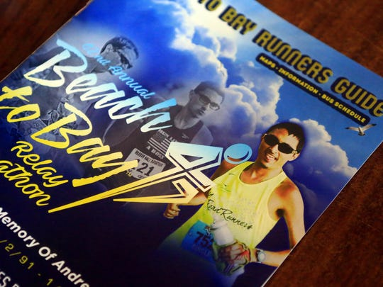A photo of the late Andre Fuqua appeared on the cover of the 42nd annual Beach to Bay relay marathon. Fuqua, 25, was killed in January 2017. His murder is one of two 2017 homicides that still are unsolved.