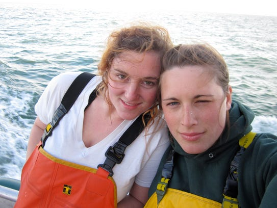 Matt Luck's daughter, Meghan, left, and fellow crewman