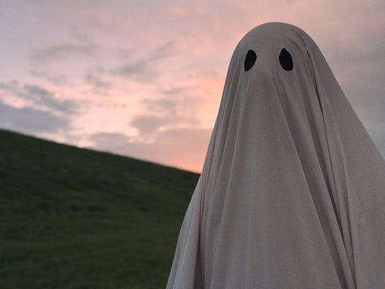 Casey Affleck wears a sheet as a man recently deceased