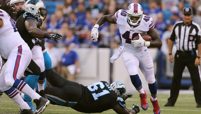 Bill running back Karlos Williams runs past Carolina defender Kyle Love (61).