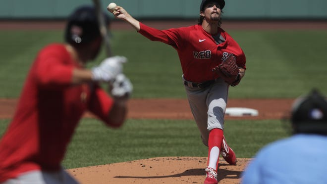 Boston's Chris Mazza delivers during a baseball practice on Thursday.